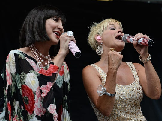 Lorrie Morgan, right, performs with Pam Tillis at the