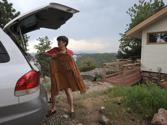Vicki Baron of Glacier View packs up her car in 2012 as the High Park Fire gets closer.