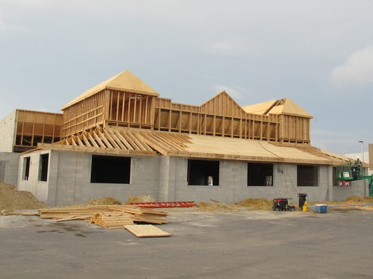Texas Roadhouse is under construction Dec. 6, 2016, in Restaurant Row near the intersection of Collier Boulevard and U.S. 41 East.