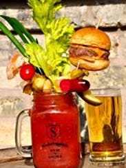 'The Masterpiece' Bloody Mary come with a cheeseburger.
