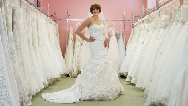 A clearance room find! This strapless Kitty Chen dress with a full train, modeled by sales associate Scout Hardin, is marked down from $1,475 to $300 at The Bridal Suite.