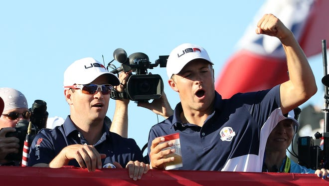 Jordan Spieth and  Zach Johnson celebrate winning the Ryder Cup during the single matches in 41st Ryder Cup at Hazeltine National Golf Club on Oct. 2.