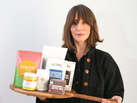 Melissa Lauprete photographed with products from At Land in Dobbs Ferry on Wednesday, December 13, 2017.