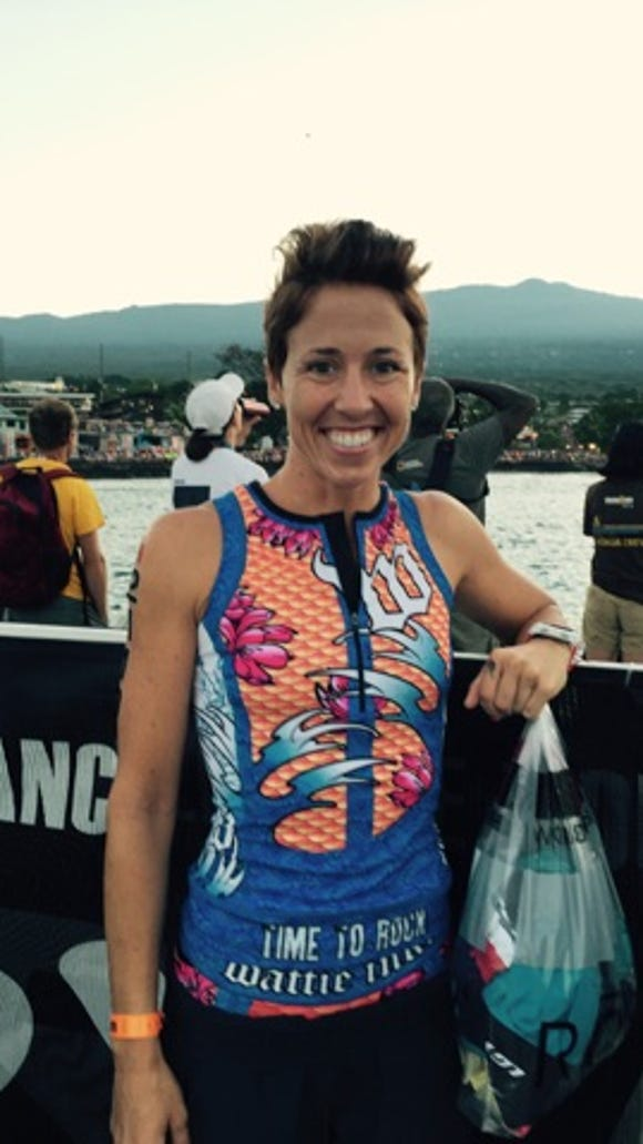 Tammy Nicholson poses for a photo an hour before the start of the 2015 Ironman World Championships in Kona, Hawaii.
