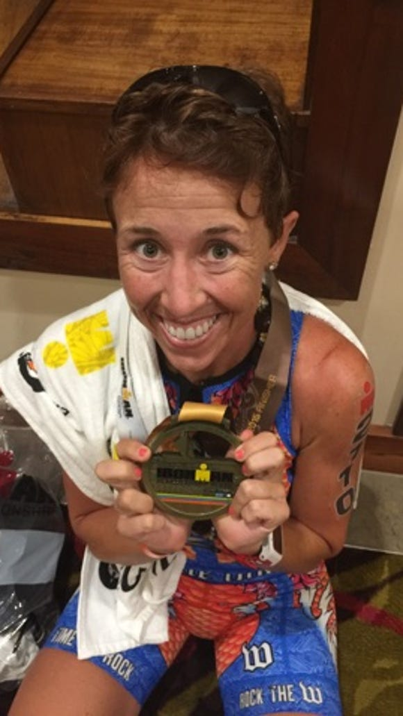 Tammy Nicholson poses for a photo after completing the 2015 Ironman World Championships in Kona, Hawaii on Oct. 10, 2015.