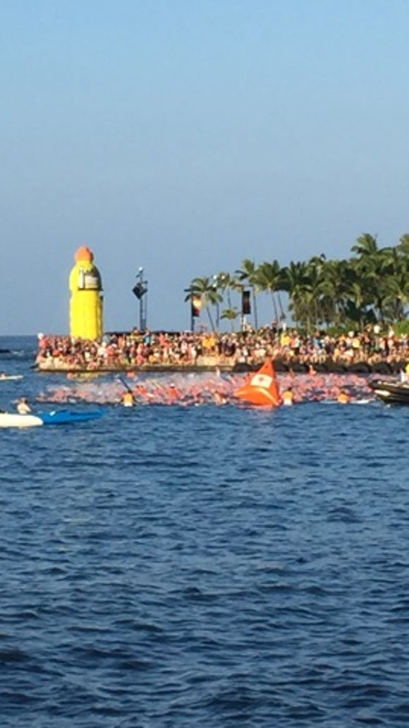 Tammy Nicholson and other competitors in her 2015 Ironman World Championship start wave begin the swim portion of the competition Saturday, Oct. 14, 2015.