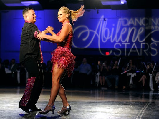 """Pam Grant dances with Jason Hernandez during the eighth annual Dancing With the Abilene Stars on Thursday, Jan. 12, 2017, at the Abilene Convention Center. The event, benefiting Hendrick Home for Children, pairs 12 local """"celebrity"""" dancers with professional dancers in choreographed routines. People """"vote"""" for their favorite dancers by way of donations, one dollar per vote. The dancer with the most votes at the end of the night is crowned the winner."""