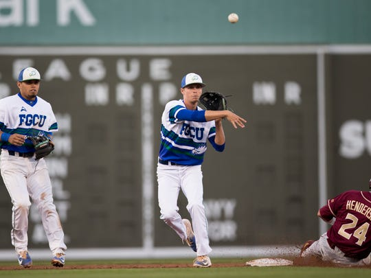 FGCU's Matt Reardon turns the double play as Florida State's Matt Henderson (24) attempts to slide into second base at JetBlue Park Wednesday, March 15, 2017 in Fort Myers, Fla.