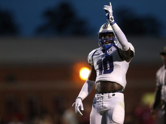 Godby's Cortez Andrews signals to the sidelines against
