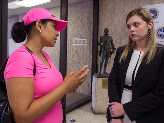 "Elizabeth Lucas (left), a survivor of domestic violence, talks with prosecutor Erica P. Matlock following a press conference by the Nueces County District Attorney's Office in which District Attorney Mark Gonzalez asked for members of the community to volunteer their time to help with the problem of domestic violence. Lucas volunteered her time to speak with victims and offenders. ""You're not a victim until you're dead,"" she said. ""You're a survivor. This is where my heart is. I can help."""