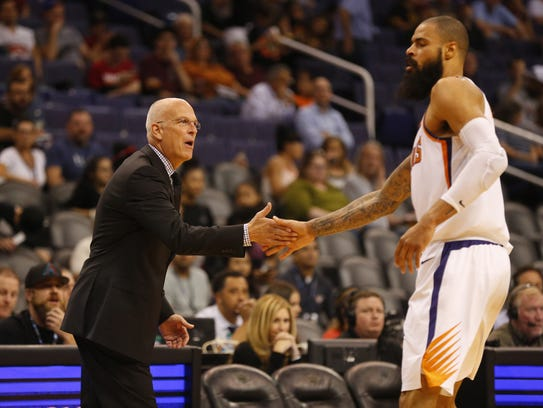 Suns interim head coach Jay Triano high fives center