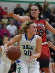 Green Bay Notre Dame's Lizzie Opichka, shown in a game on Jan. 12 against Pulaski, is one of five juniors the Tritons will have in their starting lineup this season.