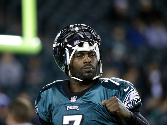 FILE - In a Dec. 22, 2013 file photo, Philadelphia Eagles' Michael Vick warms up before the first half of an NFL football game between the Philadelphia Eagles and the Chicago Bears, in Philadelphia. The New York Jets signed quarterback Michael Vick and released Mark Sanchez on Friday, March 21, 2014. Vick was a free agent after spending the last five seasons with the Phialdelphia Eagles. (AP Photo/Matt Rourke, File)