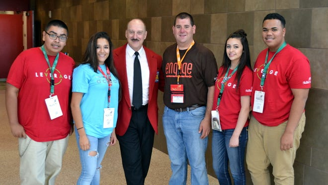 DHS SkillsUSA State Officers, from left, Julian Zepeda, Karina Saldivar and Shawn Roberts post with Tim Lawrence, Executive director of SkillsUSA.