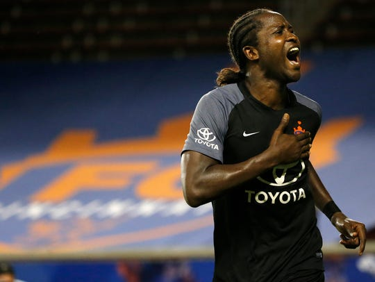 FC Cincinnati striker Djiby Fall (9) celebrates the