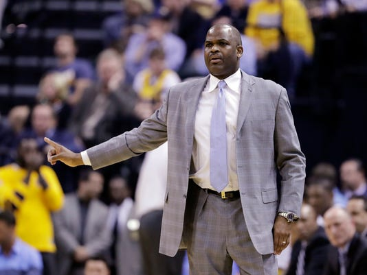 Indiana Pacers coach Nate McMillan calls a play during the first half of the team's NBA basketball game against the Atlanta Hawks, Wednesday, April 12, 2017, in Indianapolis. (AP Photo/Darron Cummings)
