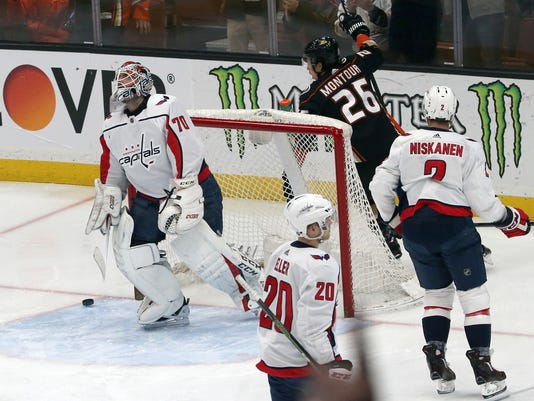 Anaheim Ducks defenseman Brandon Montour (26) celebrates a goal by defenseman Hampus Lindholm, not seen, as Washington Capitals goalie Brandon Holtby (70) looks up during the first period of an NHL hockey game in Anaheim, Calif., Tuesday, March 6, 2018. (AP Photo/Reed Saxon)