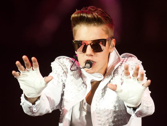 Justin Bieber performs on Wednesday, July 10, 2013, at Bankers Life Fieldhouse in Indianapolis Adam Wolffbrandt / The Star