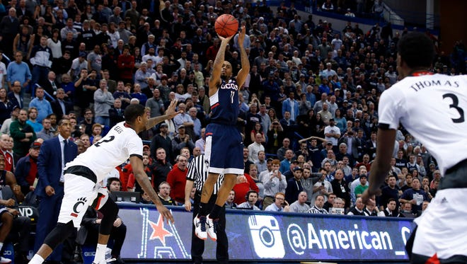 UConn's Ryan Boatright hits a three-pointer to win Friday's game against the Bearcats.