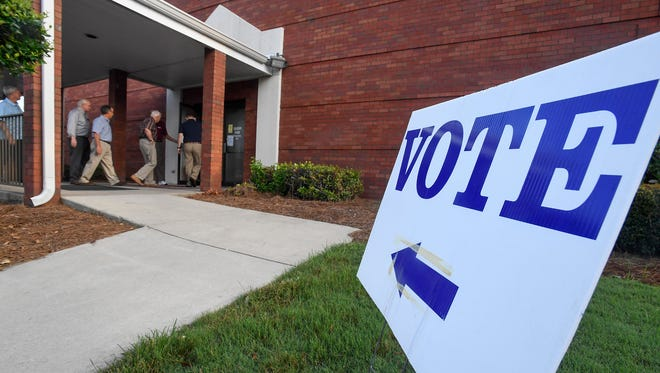 Voters arrive to vote in the U.S. Senate primary  election at Vaughn Park Church of Christ in Montgomery, Ala. on Tuesday morning August 15, 2017.