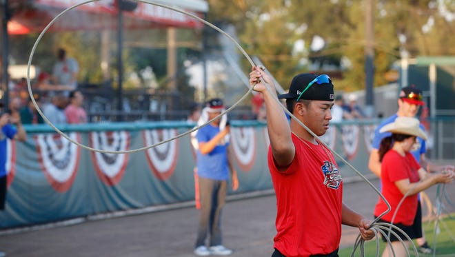 Bo Takahashi tries his hand at roping at the 2017 Cal League All-Star Fan Fest at Recreation Park. Takahashi is a member of the Visalia Rawhide's starting pitching rotation.