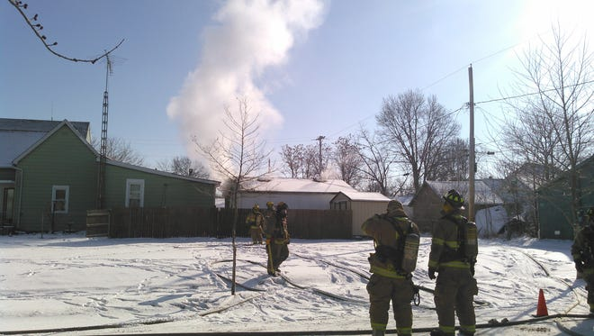 Firefighters responded to this structure fire in the 300 block of East 8th Street Thursday morning.