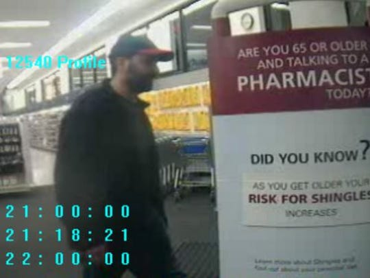 A surveillance photo showing a man believed to be involved in an Xbox Live coupon scam in Reno. The photo was taken from security cameras at a local Walgreens.