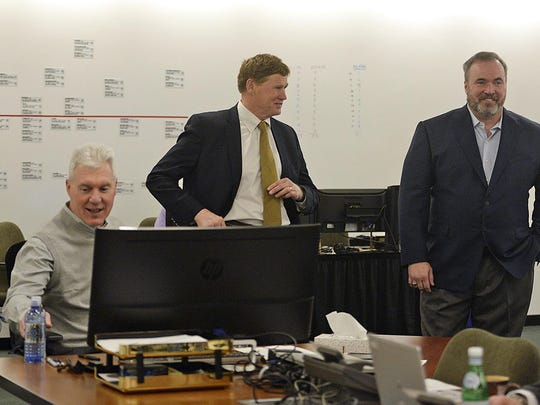 From left, Green Bay Packers general manager Ted Thompson, President and CEO Mark Murphy, coach Mike McCarthy and director of player personnel Eliot Wolf work inside the war room during the NFL draft April 30.