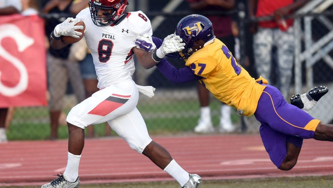 Petal High School running back Stephon Huderson runs the ball in for a touchdown in a game against Hattiesburg High School on Saturday in Hattiesburg.