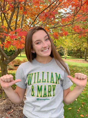 Clinton High School's Sophie Chandler poses for a picture in a William & Mary shirt after committing to compete for the Tribe in gymnastics.