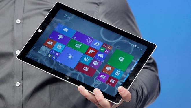 Panos Panay, Microsoft's vice president for Surface computing, introduces the Surface Pro 3 tablet device at a media preview in New York.