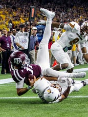 Texas A&M Aggies quarterback Kyle Allen dives to score a touchdown during the fourth quarter against the Arizona State Sun Devils at NRG Stadium.