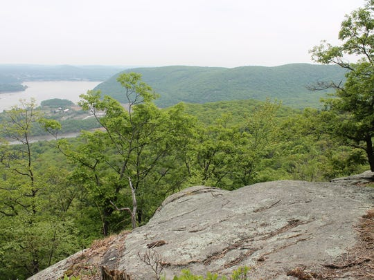 After the first steep incline, the stairs level out to a nice rest spot with the first views of the Hudson River.