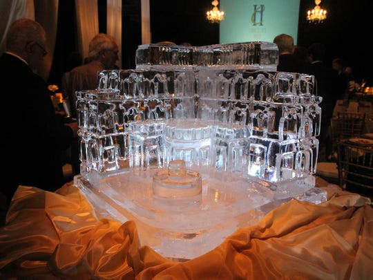 An ice sculpture of Chancellor's House greeted guests at a big reveal Friday of the hotel's features.