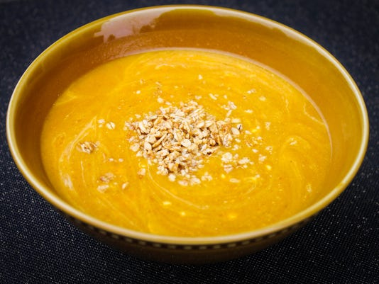 Creamy Vegan Pumpkin Soup with Pumpkin Almond Butter Granola. Photo courtesy of Nuts About Granola