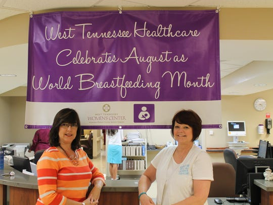 Deena Kail, left, and Kathy Medlin, right, pose with a banner for World Breastfeeding Month at Jackson-Madison County General Hospital.