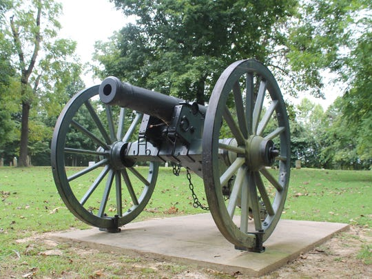 A replica Civil War cannon sits on an original carriage from Shiloh at Salem Cemetery Battlefield.
