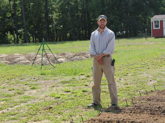Tanner Cartwright stands near the fields he has planted