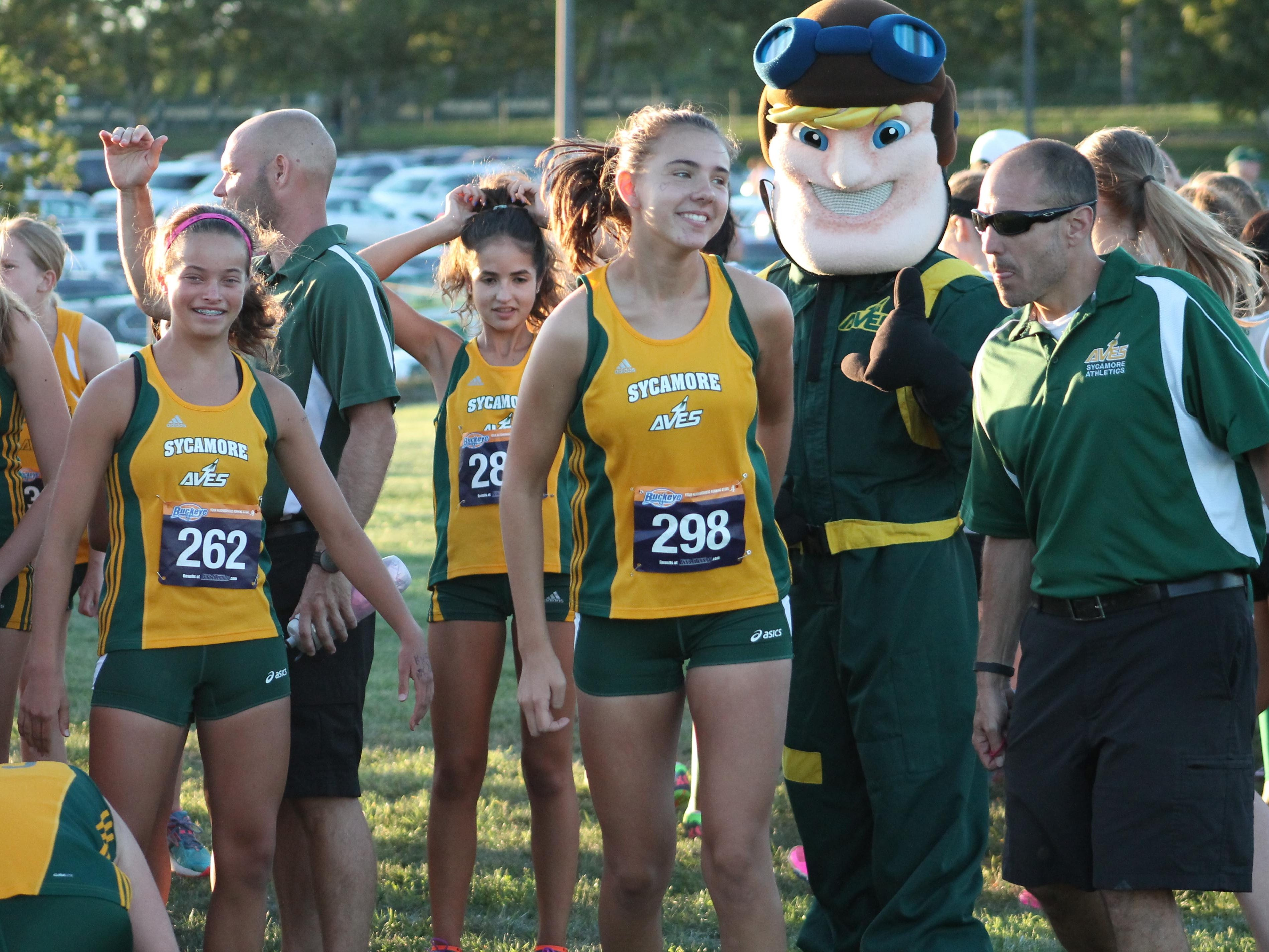 Sycamore's girls cross country team along with the Aviator mascot prepare for the start of the Sycamore Sunset Invitational Aug. 24.