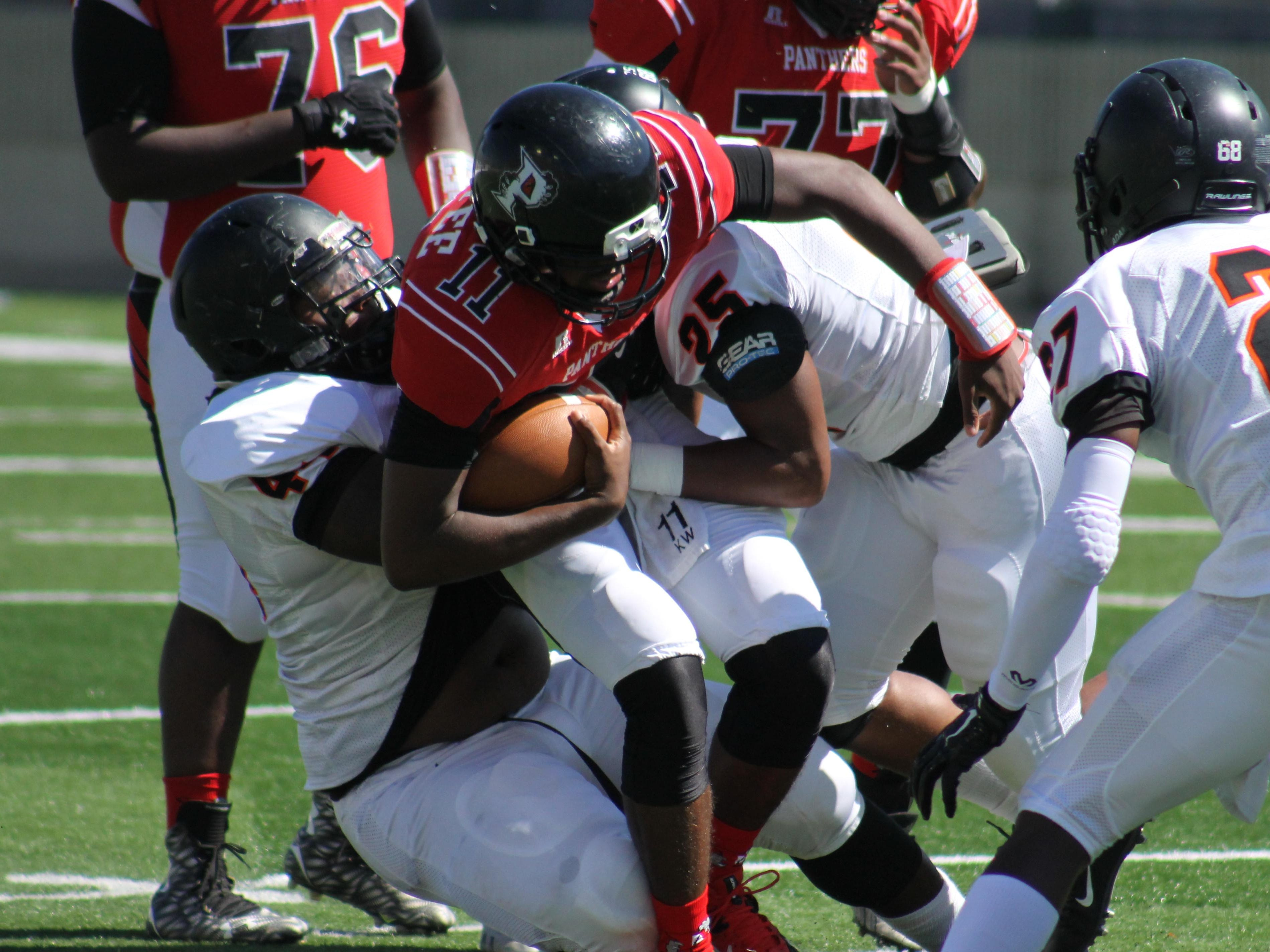 Parkway's Keondre Wudtee fights for yards against Gladewater Saturday at Independence Stadium.