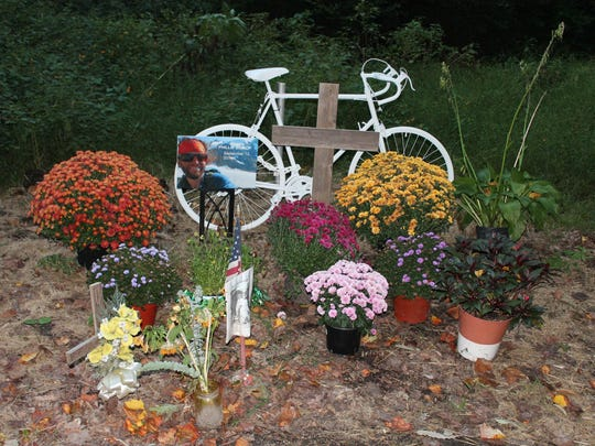 """Cycling enthusiasts erected a """"ghost rider"""" memorial at the site on Brackenville Road in Hockessin where Phillip Bishop was killed."""