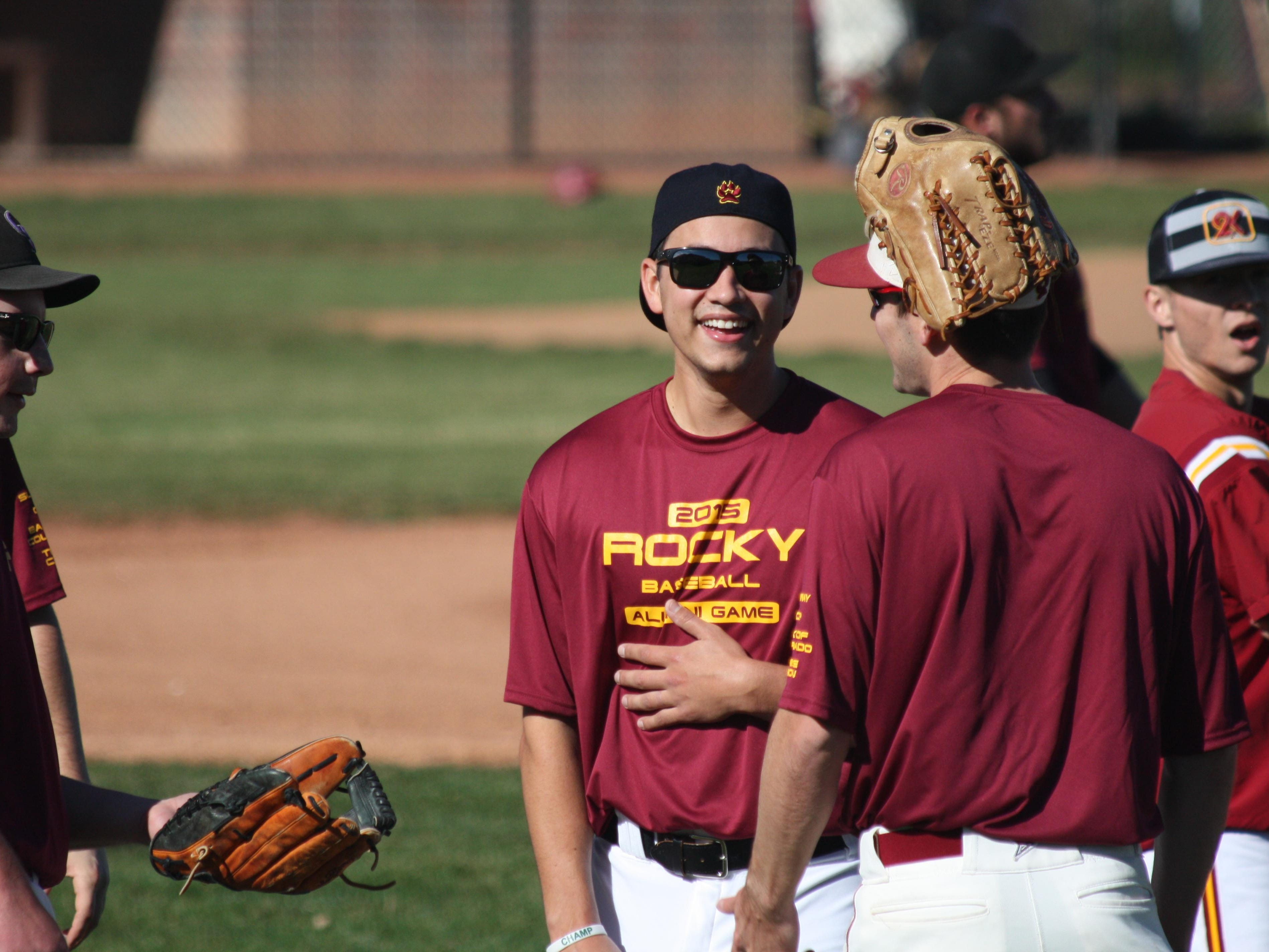 Former Rocky Mountain and current St. Louis Cardinals pitcher Marco Gonzales jokes with teammates before Saturday's alumni game.
