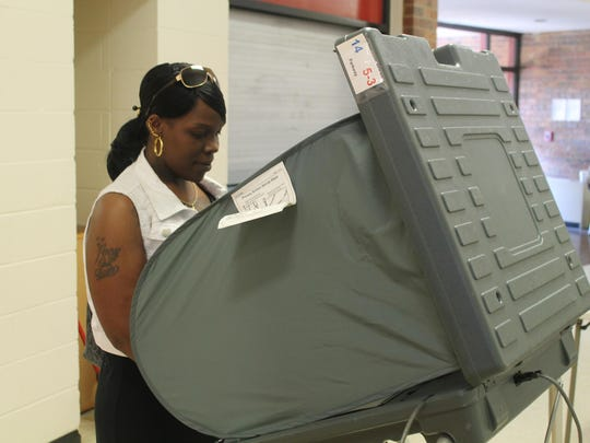 A voter casts her ballot at North Parkway Middle School in the May 2015 Jackson municipal election. 2016 will be a busy election year at the local, state and national levels.