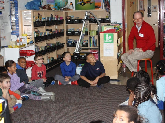 Next member David Underdown talks to a classroom of students at Greenfield Elementary School.