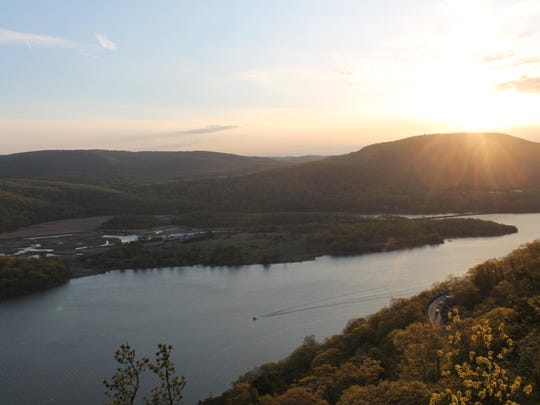 The sun sets over Bear Mountain and Iona Island, as seen from the Camp Smith Trail on Manitou Mountain.