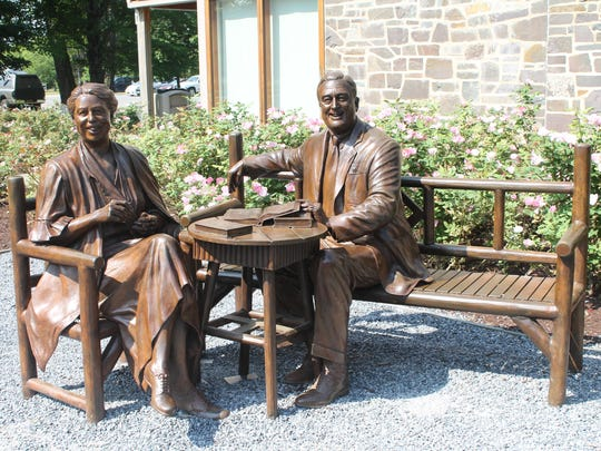 A statue of the Roosevelts greets visitors at the Franklin D. Roosevelt Historic Site.