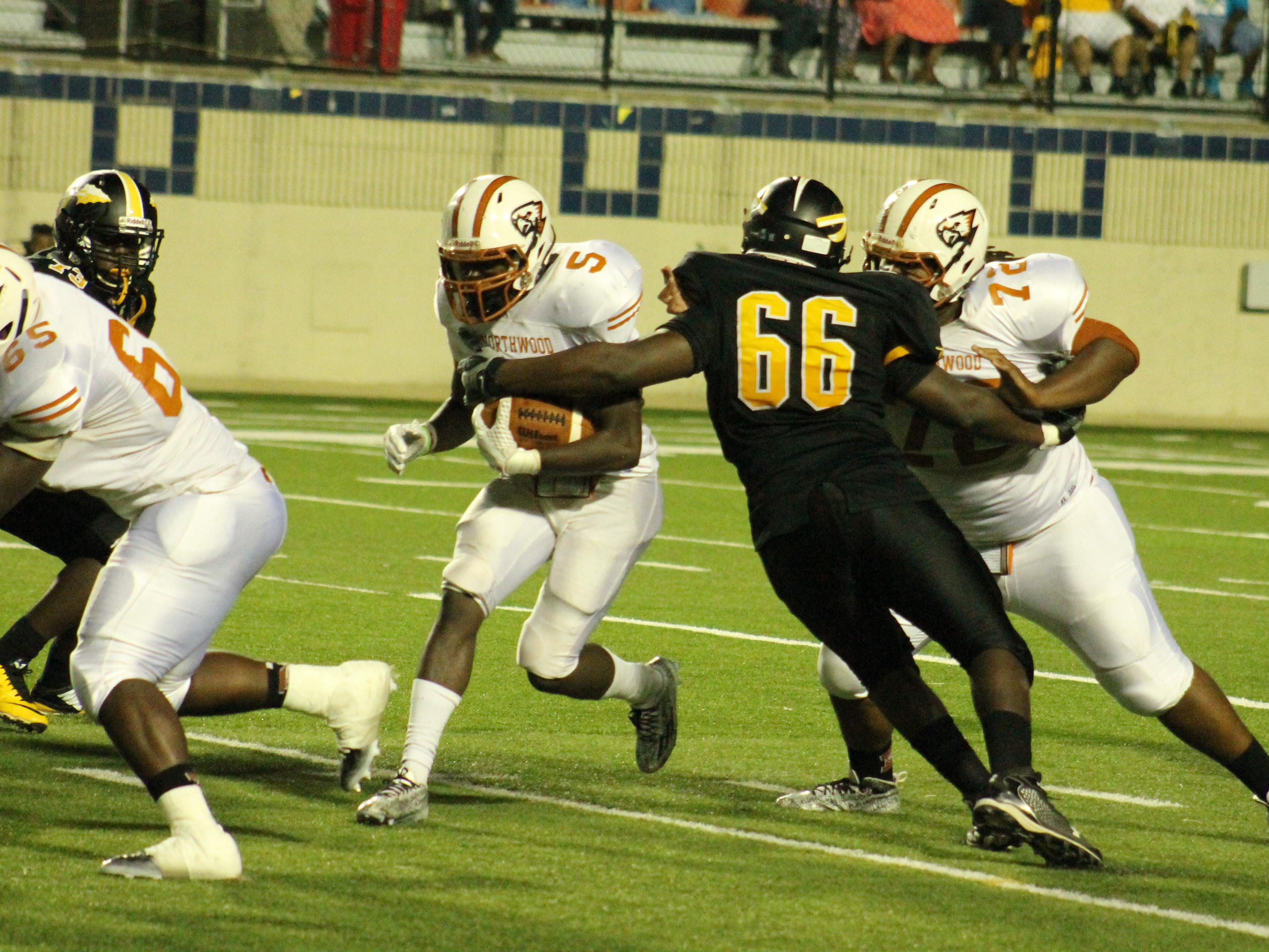 Fair Park's Dontae Cawthorne (66) makes a tackle in a game against Northwood last season.