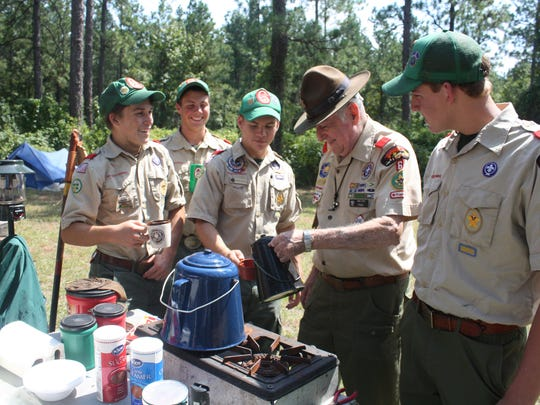 Ernest Story (second from right) chats with Scouts at a Scout Camporee held in his honor in Sept. 2011 at Camp Attakapas near Jena. Scouts pictured from his Troop 6 are Zachary Jeansonne (far left), Michael Smilie, Jason Badeaux and Wyatt Thiels (far right). - Melinda Martinez/mmartinez@thetowntalk.com