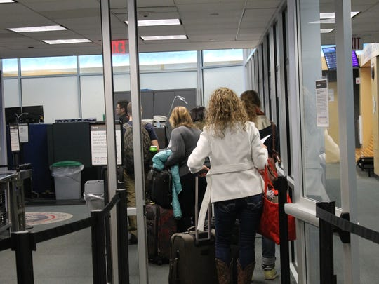 Travelers line up for security checks Tuesday afternoon at the Burlington International Airport.