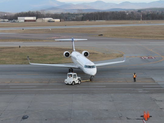 A plane is moved on the Burlington International Airport runway Tuesday afternoon.